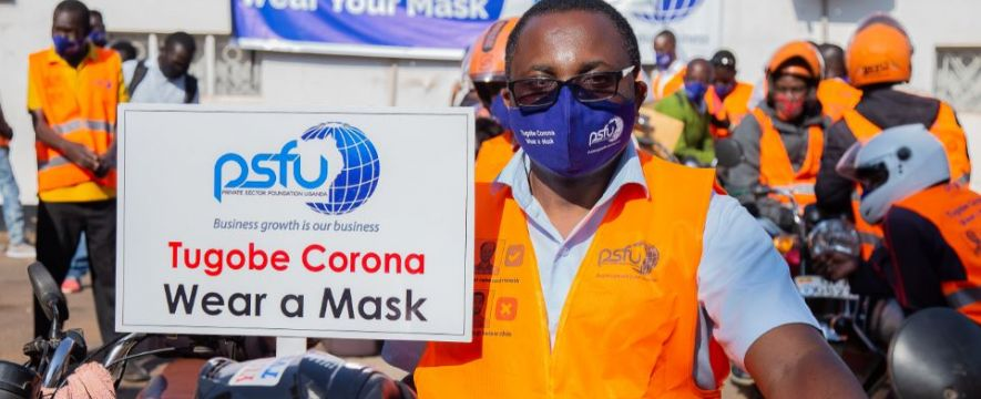 Mr. Francis Kisirinya, Deputy Executive Director demonstrates how a mask should be worn